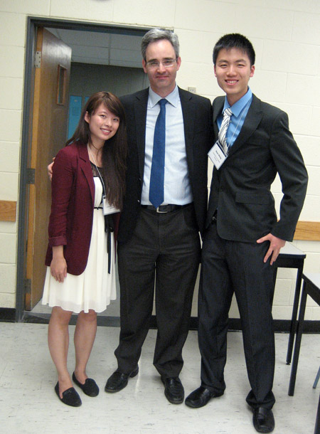 Sherri Cui (left) and Shen Wang (right) with Engineering Science Associate Chair Costas Sarris at the awards ceremony.