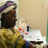 A doctor performs an HIV test in Munoko, Uganda (Photo: Arne Hoel via Flickr).