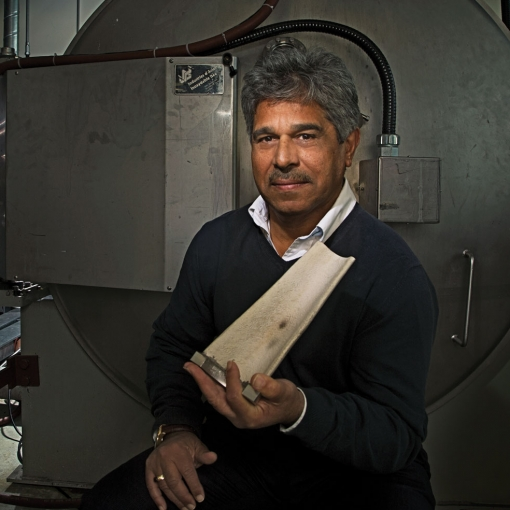 Professor Javad Mostaghimi holding a piece of foam shaped like a turbine blade. The foam has been coated with zirconia — a thermal barrier. Air can flow through the foam and cool the blade so that it can withstand temperatures greater than 1000C (Photo: Rob Waymen).
