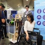 Angela Chen demonstrates The Swivet at the Innovative Designs for Accessibility (IDeA)