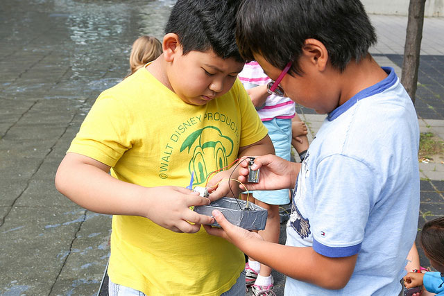 Campers working on their miniature fan boats