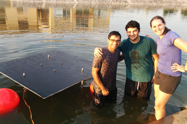 Graduate students Shakya Sur, Ahmed Mahmoud, and Professor Amy Bilton