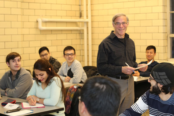 Randy Sinukoff, a Senior Associate at Stantec Consulting Ltd., teaching his graduate level course, CHE1431H Environmental Auditing. (Photo by Tyler Irving)