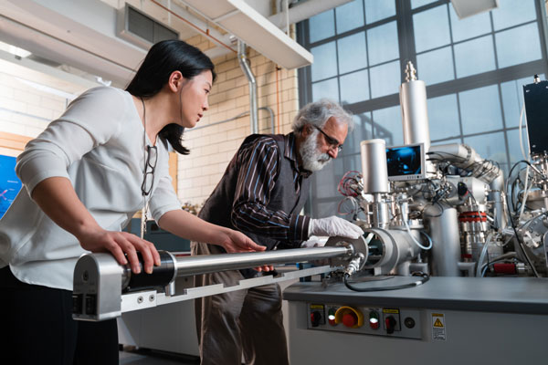 Pei-Yu Kuo, a PhD candidate in Forestry, and Rana Sodhi, Senior Research Associate and adjunct professor (ChemE), work on the new secondary ion mass spectrometer at the Characterization of Advanced Materials (OCCAM). (Photo: Neil Ta)