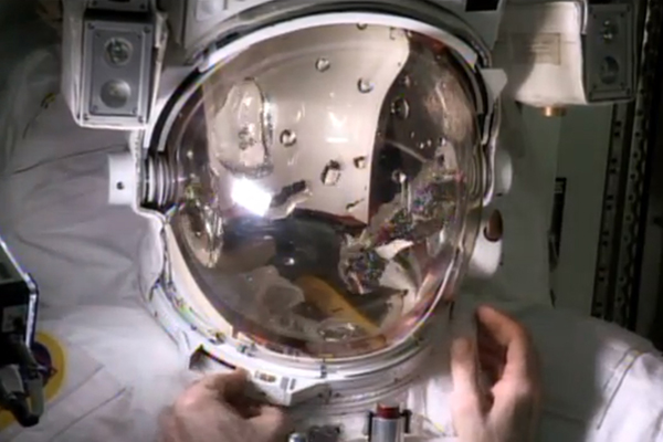 Astronaut Luca Parmitano fills a helmet with water to demonstrate his near-drowning emergency during a spacewalk (Image: NASA TV).