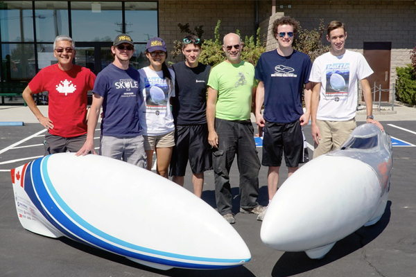 The U of T Engineering Human Powered Vehicle Design Team standing next to Eta Prime and Vortex (from left to right): Prof. Jun Nogami (MSE), Calvin Moes (EngSci 1T5, MSE MASc Candidate), Sherry Shi (EngSci 1T6), Rossdan Craig (Year 3 EngSci), Chris Williams, Thomas Ulph (Year 4 EngSci) and Evan Bennewies (Year 3 EngSci)