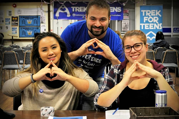Michael Bazzocchi, centrem with Trek for Teens volunteers. Bazzocchi's organization has raised more than $60,000 in support of charities that aid homeless youth. (Courtesy of Michael Bazzocchi)