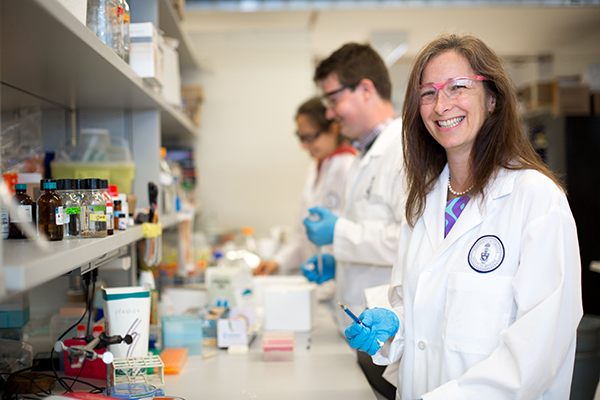 University Professor Molly Shoichet (IBBME, ChemE), holds the hyaluronic acid (HA)-based injectable hydrogel developed in her lab that helps transplanted stem cells survive, integrate and repair damaged tissue in the brain and eye. Shoichet has been named the recipient of the 2016 Till & McCulloch Award. (Credit: Roberta Baker).