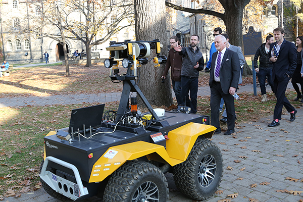 Steve Carlisle, head of General Motors Canada, learns about autonomous robotics research in the Barfoot Lab at U of T's Institute for Aerospace Studies. (Credit: Roberta Baker)