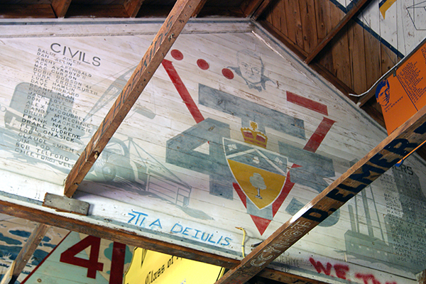 U of T Engineering students of the class of 4T3, choosing to complete their education during the Second World War, painted a mural in the rafters featuring a portrait of Winston Churchill and his line,