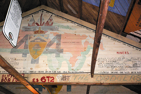 The mural painted by the U of T Engineering class of 4T4 in the rafters at Gull Lake Survey Camp.