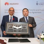 Professor Vivek Goel (left), vice-president, research & innovation for the University of Toronto, and Jun Zha, president of Huawei's Central Research Institute, celebrate the signing of a bilateral strategic partnership agreement between the two groups. (Credit: Roberta Baker).