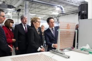 John Paul Morgan (right) demonstrates his pioneering solar optic technology to Ontario Premier Kathleen Wynne. (Courtesy: John Paul Morgan)