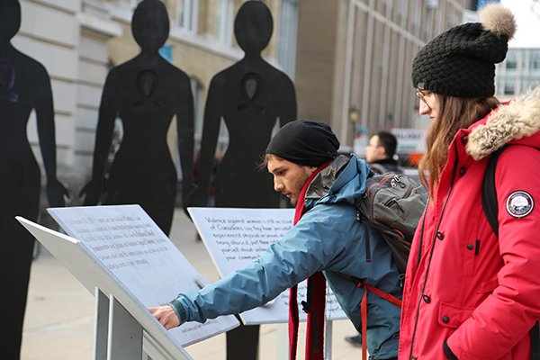 Students interact with the monument to commemorate the National Day of Remembrance and Action on Violence Against Women, December 6, 2016. (Credit: Kevin Soobrian)
