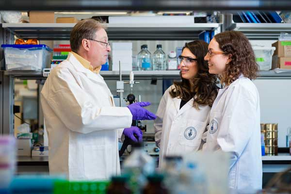 From left: Professor Paul Santerre (IBBME), pictured with PhD candidates Yasaman Delaviz and Meghan Wright, is developing implantable materials that can activate the body's innate response to damage, including heart attacks. (Credit: Neil Ta)