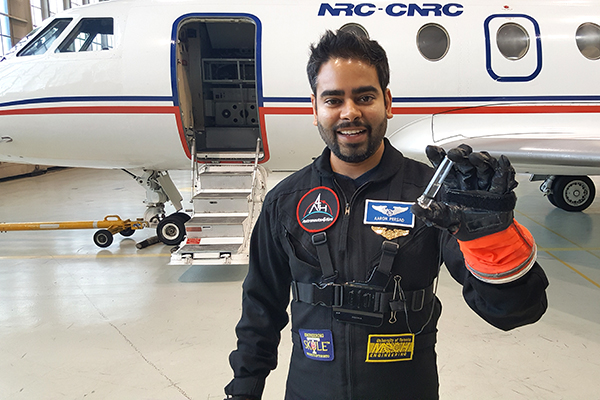 Aaron Persad shows off a small sample of water he took on a microgravity simulation test flight in November 2016. Persad is one of 70 candidates the Canadian Space Agency is considering to become Canada's next astronaut. (Photo courtesy Aaron Persad).