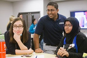 Professor Chirag Variawa (centre) teaches both graduate and undergraduate students and is encouraging them to address educational challenges through engineering design. (Photo: Alan Yusheng Wu)