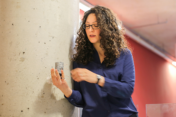 Professor Fae Azhari (MIE, CivE) holds a sample of the self-sensing concrete she designed. Her work helps monitor the structural health of crucial infrastructure such as bridges, roads and hydroelectric dams. (Credit: Roberta Baker).
