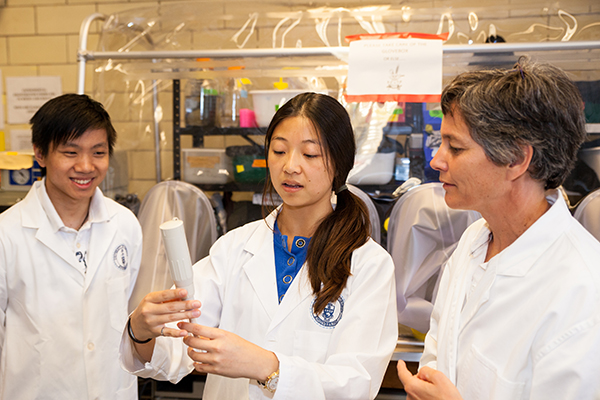 Professor Elizabeth Edwards (ChemE, right), is being honoured with a 2017 Faculty Award for her pioneering research, which also demonstrates the best in cross-disciplinary collaboration, and for outstanding teaching. The annual prize recognizes U of T teaching staff who consistently demonstrate all-around excellence in both their scholarly work and in the classroom. (Credit: Sara Collaton)