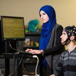 Zahra Emami, left, and Filip Stojic (both IBBME MASc candidates) work on a project to develop a brain-computer interface. Engineers Canada predicts a shortage of 100,000 engineers in the next decade — with their advanced skills and training, postgraduate degree holders are equipped to prevent this impending engineering shortfall. (Credit: Neil Ta)