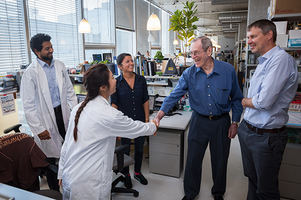 Shreya Shukla (third from right) meets stem cell pioneer James Till (second from right), as he tours the laboratory of Peter Zandstra (right) in July 2015. Also pictured are graduate students Jennifer Ma (front) and Nimalan Thavandiran (left). (Photo: James Poremba).