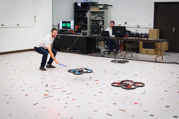Graduate students Mario Vukosavljev and Thomas Bamford experiment with visual tracking in drones in Professor Anglea Schoellig's lab at the University of Toronto Institute for Aerospace Studies (UTIAS). (Photo: Yani Macute)