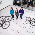 Professor Anglea Schoellig with graduate students Karime Pereida Pérez and Thomas Bamford. Schoellig is co-chairing the first international symposium of the Centre for Aerial Robotics Research and Education (CARRE). (Photo: Neil Ta)