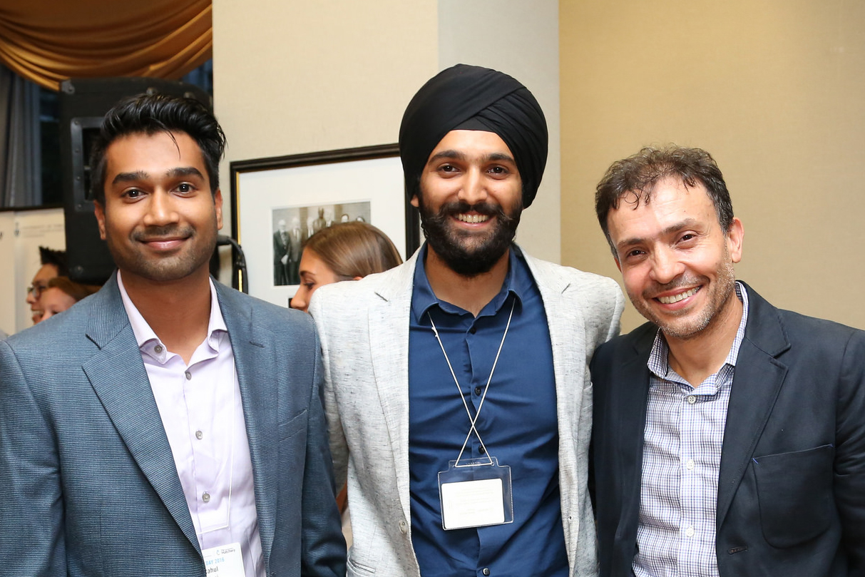 From left: Rahul Udasi (MIE MEng 1T6) and Manmeet Maggu, co-founders of Trexo Robotics, celebrate with Joseph Orozoco of The Entrepreneurship Hatchery. Trexo won the $20,000 Lacavera Prize at the Hatchery's 2016 Demo Day, and are now joining the inaugural cohort of Hatchery Launch Labs. (Credit: Roberta Baker)