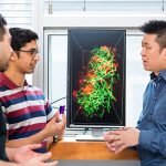 From left, IBBME PhD candidates Abdullah Syed and Shrey Sindhwani in the lab of Professor Warren Chan, right. The research team has published a paper investigating the challenges faced by therapeutic nanoparticles in reaching cancerous tumours. (Credit: Neil Ta)