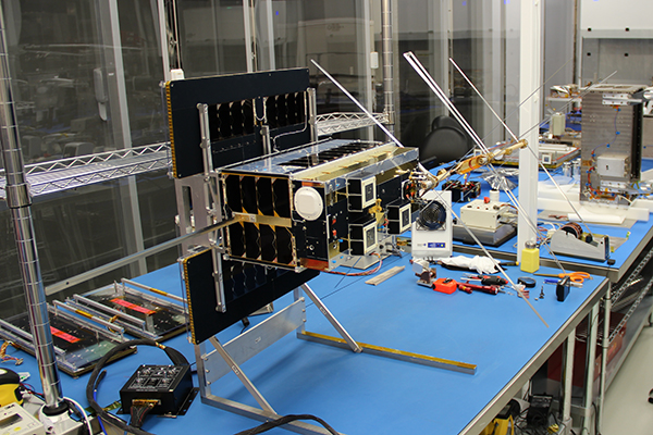The NORsat-2 satellite, designed and built by Professor Robert Zee and his team, in the Space Flight Laboratory's clean room at the University of Toronto's Institute for Aerospace Studies. (Credit: UTIAS/SFL).