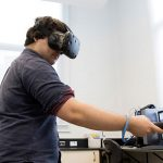 Alexander Sullivan tests out the lab simulation. (Photo: Romi Levine)
