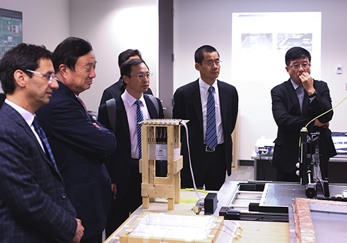 Ren Zhengfei takes a tour of the electromagnetics lab of Professor George Eleftheriades (ECE). (Photo: Tristan Cannon-Sherlock) .