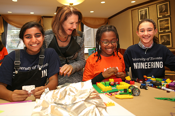 Dean Cristina Amon works with elementary school students as they design their vision for the neighbourhood of the future at a U of T Engineering outreach event Oct. 17, 2017. Increasing diversity in its programs and the profession is a central goal of the Faculty's new Academic Plan, which the U of T community is invited to provide feedback on by Nov. 17. (Credit: Roberta Baker).