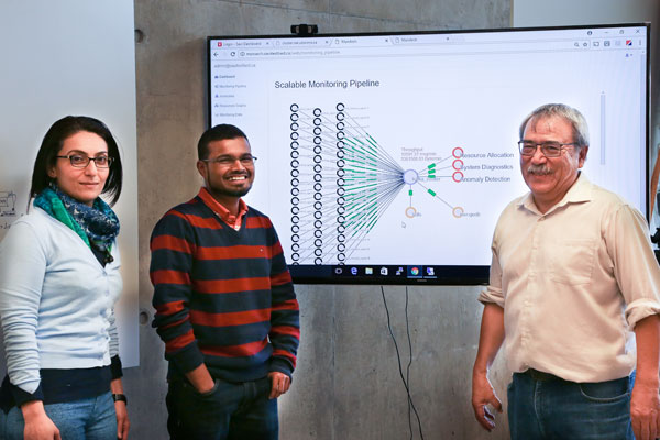 Professor Alberto Leon-Garcia (ECE), seen here with graduate students Atoosa Nasiri (left, ECE PhD candidate) and Rajsimman Ravichandiran (centre, ECE MASc candidate), heads the new NSERC Collaborative Research and Training Experience program in Network Softwarization. (Photo: Tyler Irving)