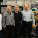 Professor Reza Iravani (ECE) and members of his research group (from left, Mr. Xiaolin Wang, Professor Reza Iravani, Dr. Ali Nabavi and Dr. Milan Graovac) are helping to reduce range anxiety for electric vehicle drivers (Photo: Jessica MacInnis)