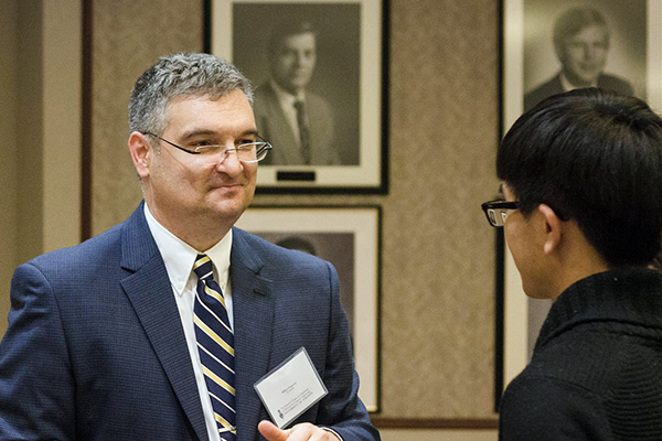 Professor Milos Popovic, at right, speaks with a U of T Engineering alumnus about his research. Popovic has been named research director of the Toronto Rehabilitation Institute. (Credit: Jonathan Sabeniano)
