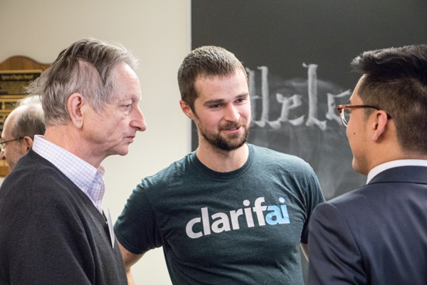 Left to right: U of T Professor Geoff Hinton (Computer Science) and alumnus Matt Zeiler (EngSci 0T9) speak with Kyle Hsu (Year 3 EngSci) at the Engineering Science Education Conference, held January 26, 2018. (Photo: Kevin Zhang)