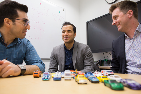 Left to right: Sina Bahrami (CivE PhD candidate), Mehdi Nourinejad (CivE PhD 1T7) and Professor Matthew Roorda (CivE) designed an algorithm to optimize the design of parking lots for autonomous vehicles, increasing their capacity by an average of 62 per cent. (Photo: Roberta Baker)