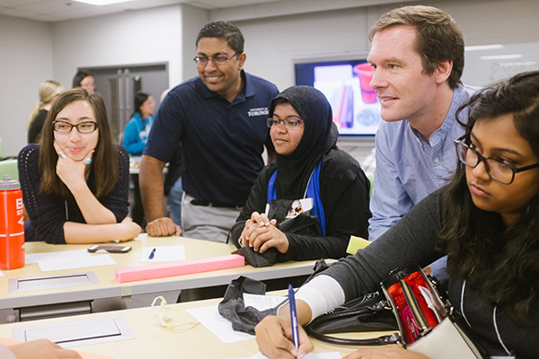 Professor Jason Foster (EngSci), second from right, works with aspiring engineers at U of T Engineering's Young Women in Engineering Symposium. Foster is receiving the 2018 Joan E. Foley Quality of Student Experience Award for outstanding contributions to improving the quality of academic or extracurricular student life. (Credit: Alan Wu).