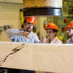 Professor Evan Bentz (CivMin, at left) works with students in the Department of Civil & Mineral Engineering's structures lab. (Credit: Neil Ta).