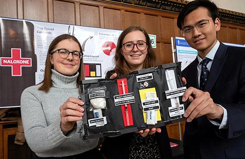 From left: Jacqueline Fleisig, Cassandra Chanen and Zhengbang Zhou show their redesigned naloxone kit