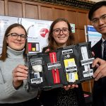 From left: Jacqueline Fleisig, Cassandra Chanen and Zhengbang Zhou (all Year 1 EngSci) show their redesigned naloxone kit at the 2018 Praxis Showcase event, April 13, 2018 in the Great Hall of Hart House. (Credit: Laura Pedersen).