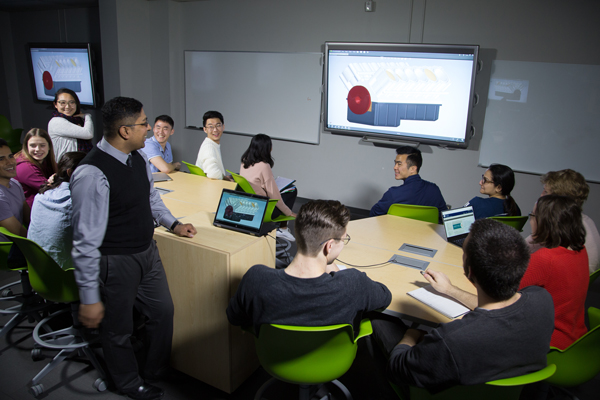Professor Chirag Variawa, Director, First-year Curriculum, teaches a course a TEAL room housed in the Sandford Fleming. This pilot TEAL project, which began in 2014, informs the approach professors will take in the new TEAL rooms that are part of the Myhal Centre. (Photo: Roberta Baker)