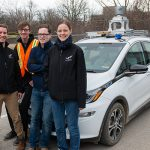 From left: aUToronto team members Zachary Kroeze (ECE PhD 1T8), Andreas Schimpe, Keenan Burnett (EngSci 1T6+PEY, UTIAS MASc candidate) and Mona Gridseth (UTIAS PhD candidate) in front of their autonomous vehicle, dubbed Zeus . The team is one of eight from universities across North America competing in the international Autodrive Challenge™. (Credit: Laura Pedersen).
