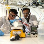Dr. Cao-Thang Dinh, left, and Dr. Md Golam Kibria (both ECE) demonstrate their new catalyst. In a paper published today in Science, their team demonstrated most efficient and stable process for converting climate-warming carbon dioxide into the building blocks for plastics, all powered using renewable electricity