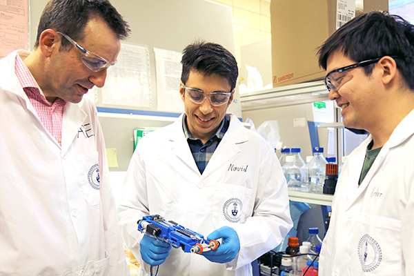From left: U of T Engineering researchers Professor Axel Guenther (MIE), Navid Hakimi (MIE PhD candidate) and Richard Cheng (IBBME PhD candidate) have created the first 'skin printer' that forms tissues in situ for application to wounds. (Credit: Liz Do)