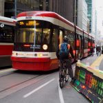 Toronto's King Street includes a complex mix of various transportation modes, including cycling, walking, driving and transit. How infrastructure impacts commuter choices is one of the topics being examined by U of T Engineering researchers within the new U of T School of Cities. (Image: City of Toronto, via Flickr)