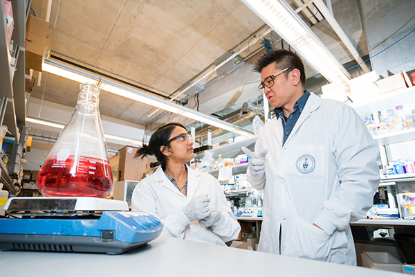 Professor Warren Chan and a student in a lab