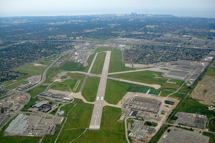 """An aerial shot of Toronto's Downsview Airport, where the Downsview Aerospace & Innovation Research hub is based. Canadian aerospace company Bombardier has announced it will invest $1.5 million over five years to fund core research at an """"aeromaterials research centre"""" at Downsview, in partnership with U of T Engineering and other institutions. (Photo by Rene Beignet via Flickr)"""