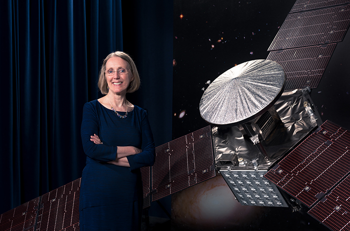 Janis Chodas, the director for engineering and science at NASA's Jet Propulsion Laboratories, stands beside a one-third scale model of the Juno spacecraft (photo courtesy of JPL).